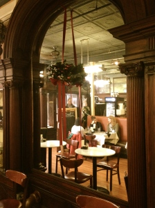 The large antique mirror is probably original to the building,
