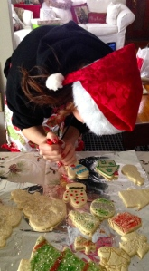 My daughter decorating Christmas cookies. There was constant motion between rolling dough, cutting out, baking and decorating.
