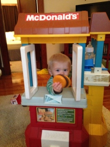 Baby serving up a McDonald's hamburg