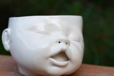 Creepy baby face planter