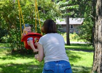 Mimi swinging Tanner