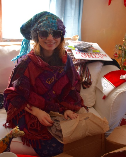 Taylor trying on her presents as she opens