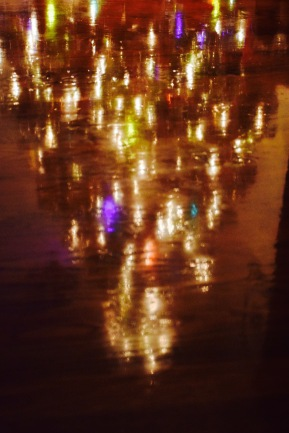 Christmas light dancing across the floor