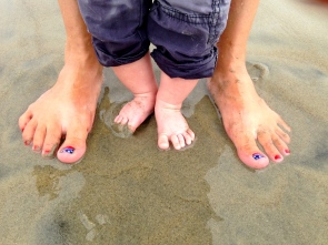 Baby and Mommy feet kissing Earth