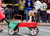 A little girl enjoying a wagon ride for the parade