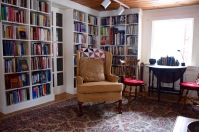 Sit in a cozy chair with one of the many books