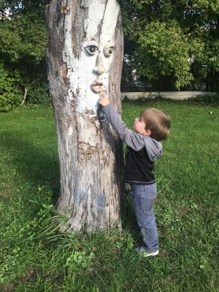 Colt age 3 with same tree on the day they moved to their new home